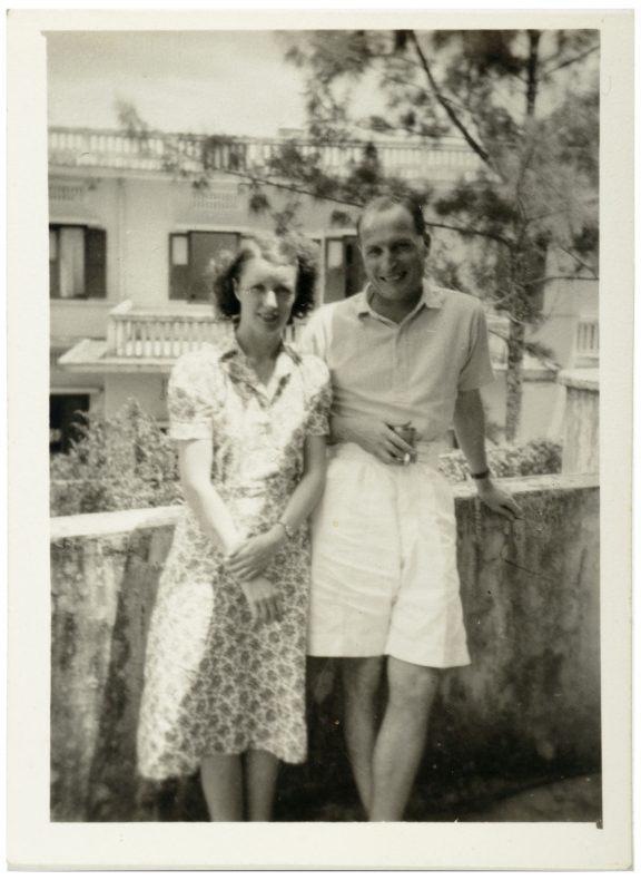 Kathleen and Harold Pether standing on a neighbour's balcony