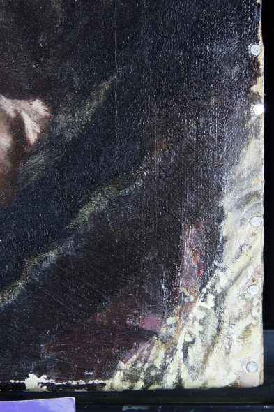 Detail of the bottom right corner of the portrait of Dr Hassell, it shows a hint of white lace.