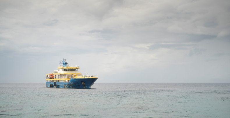 Boat in vast ocean