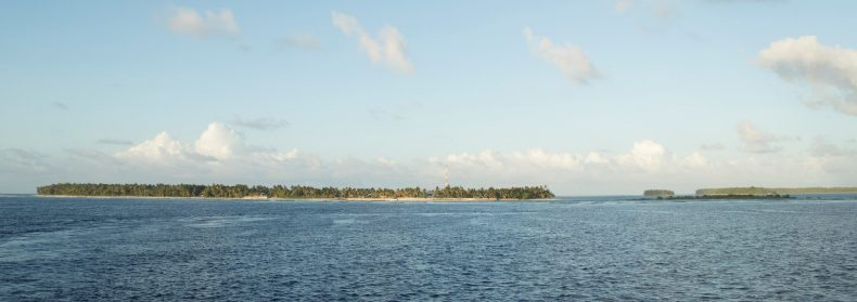 Panoramic shot of the Atafu atoll, a low-lying land mass