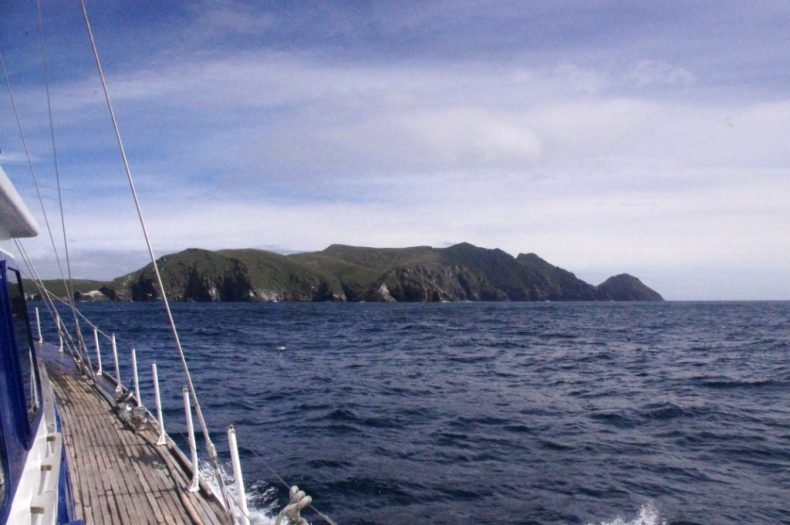 Disappointment Island from the deck of Evohe, as we approached from the north-east. Photograph by Colin Miskelly. Te Papa