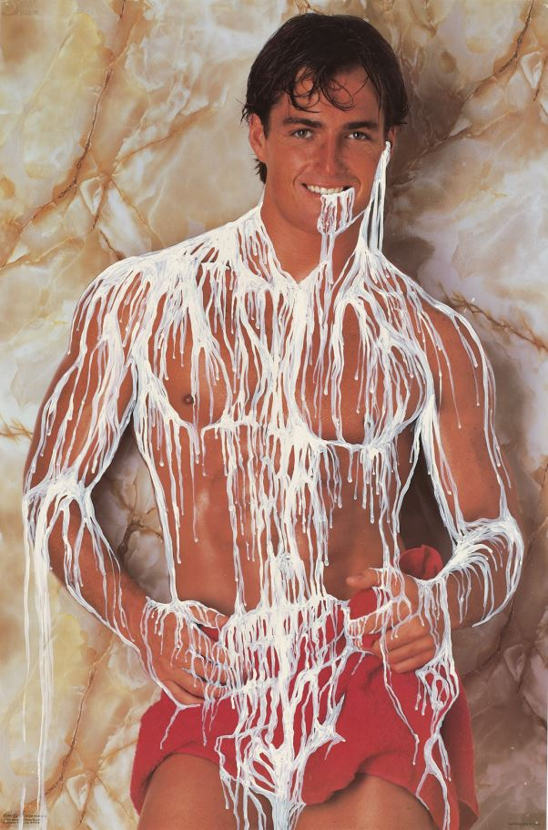 A man posing topless covered in a white substance