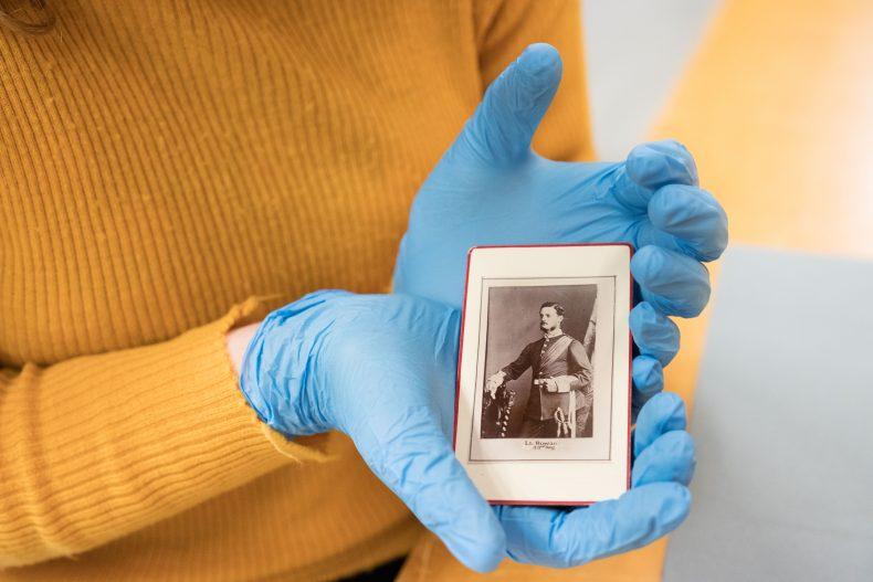 Caitlin holding a photograph of Frederick Rowan