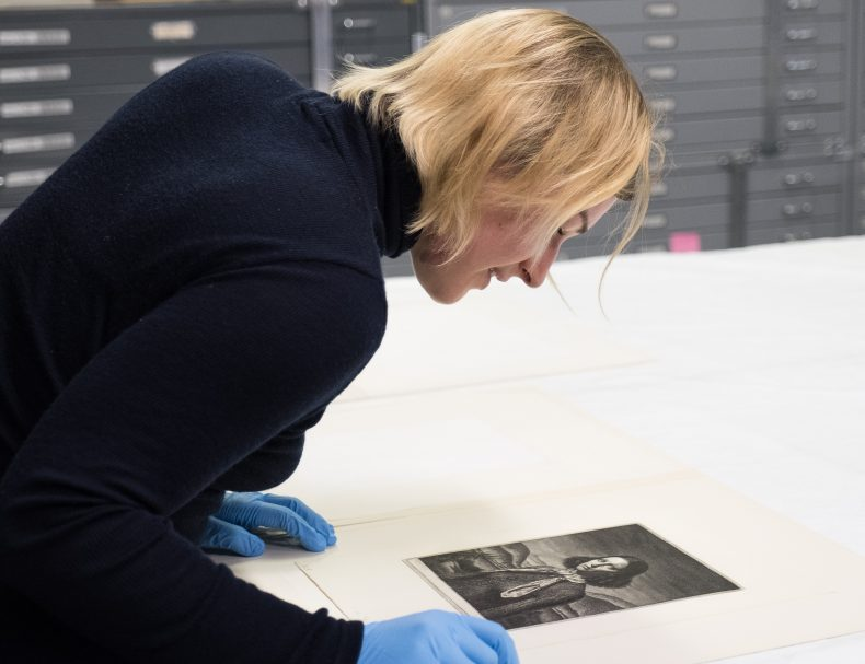 Lady looks at etching