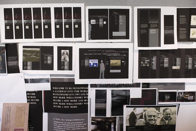 Various print-outs on a wall showing the typeface in example uses