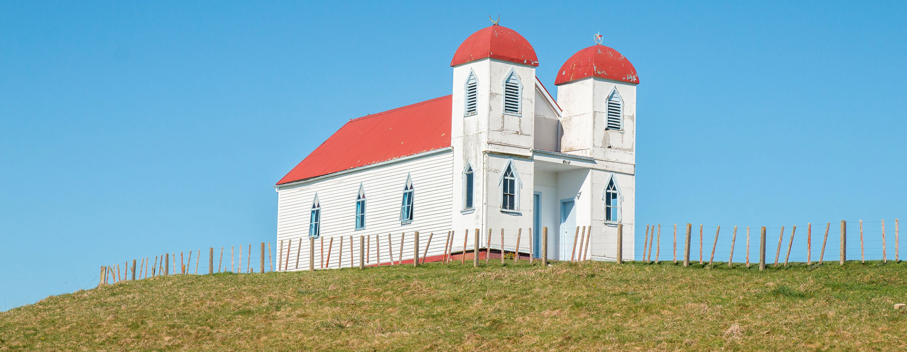 White church building with red roof
