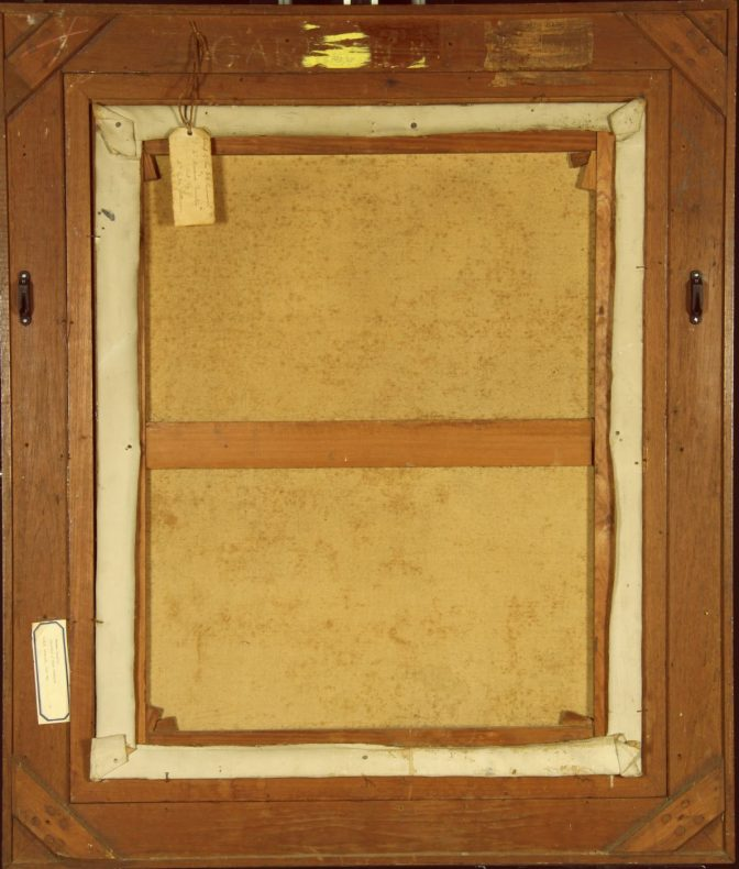 The back of a painting, showing the framing and the canvas sitting inside it, along with a tag hanging from the frame