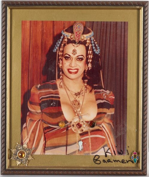 Framed photograph of Carmen Rupe