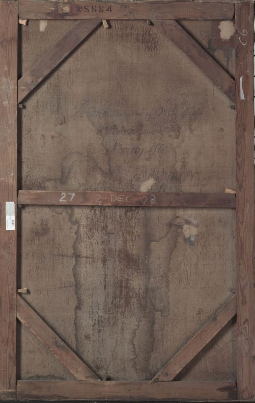 The back of a painting, showing the framing and also signs of age, including a stain