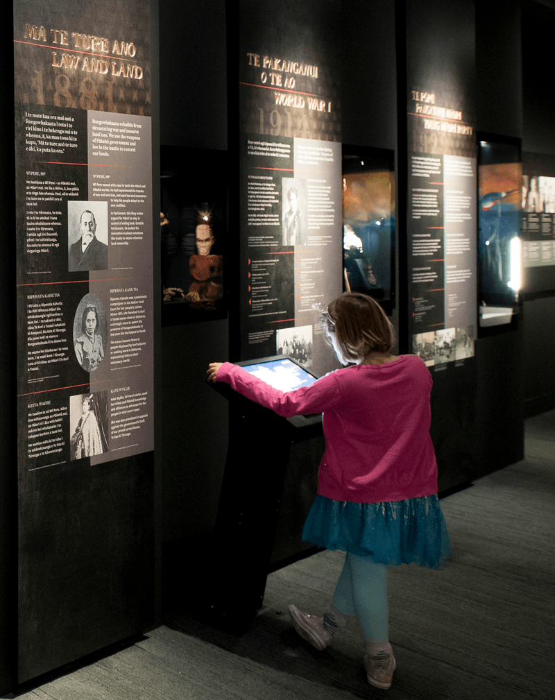 A child uses a digital label in an exhibition