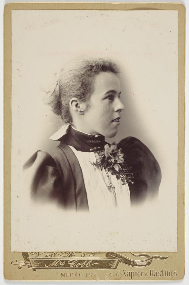 Portrait of woman looking off camera, wearing a corsage
