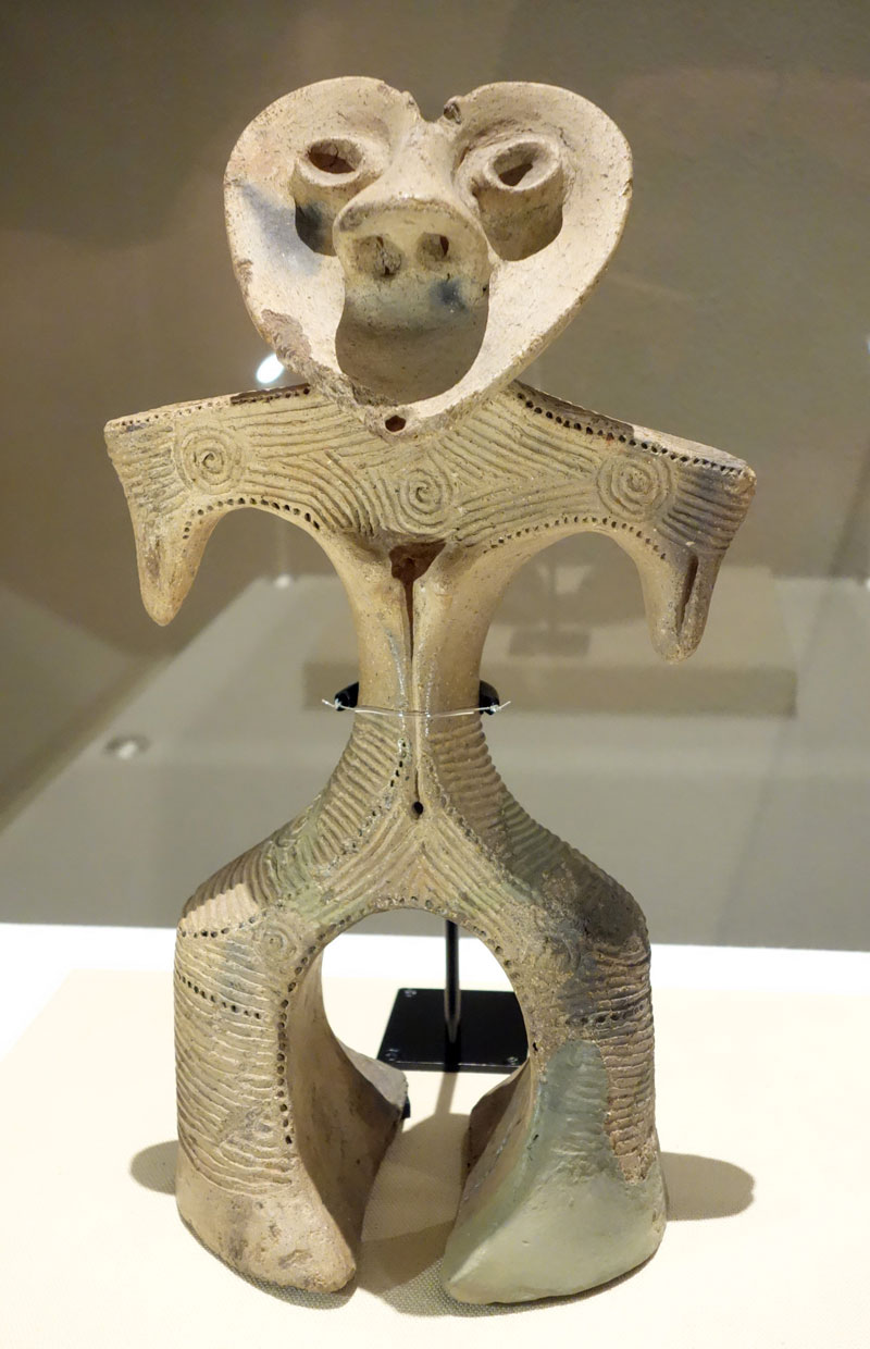 Sculpture of a figurine with a head shaped like a heart