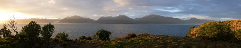 Panoramic view of a mountain range on the other side of a body of water