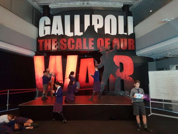 Students use 3D scanners to record their emotional responses outside Gallipoli: The Scale of Our War exhibition, Te Papa