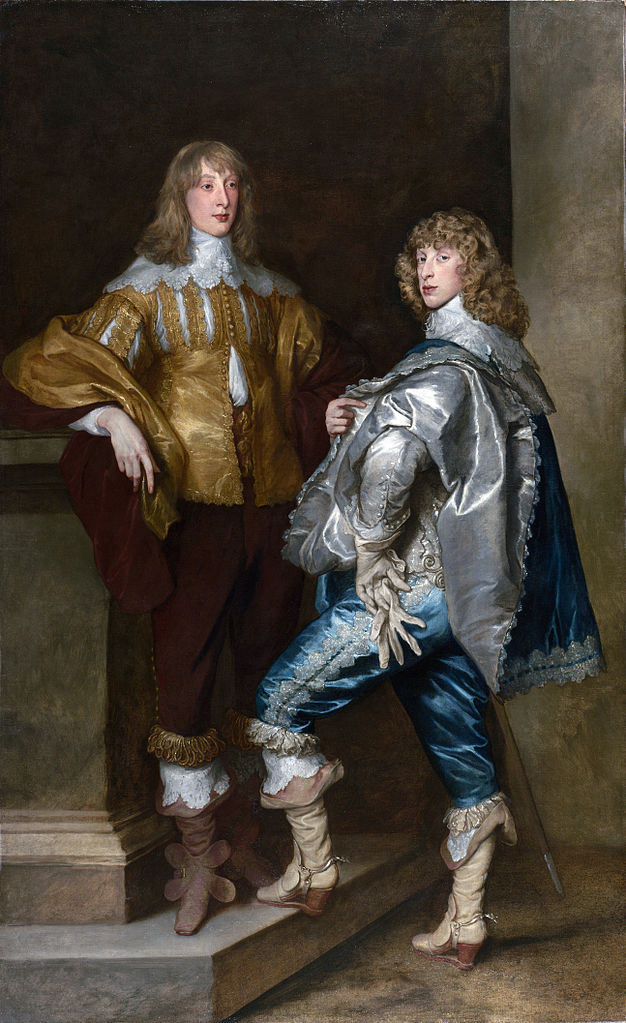 Two men pose dressed in opulent clothing