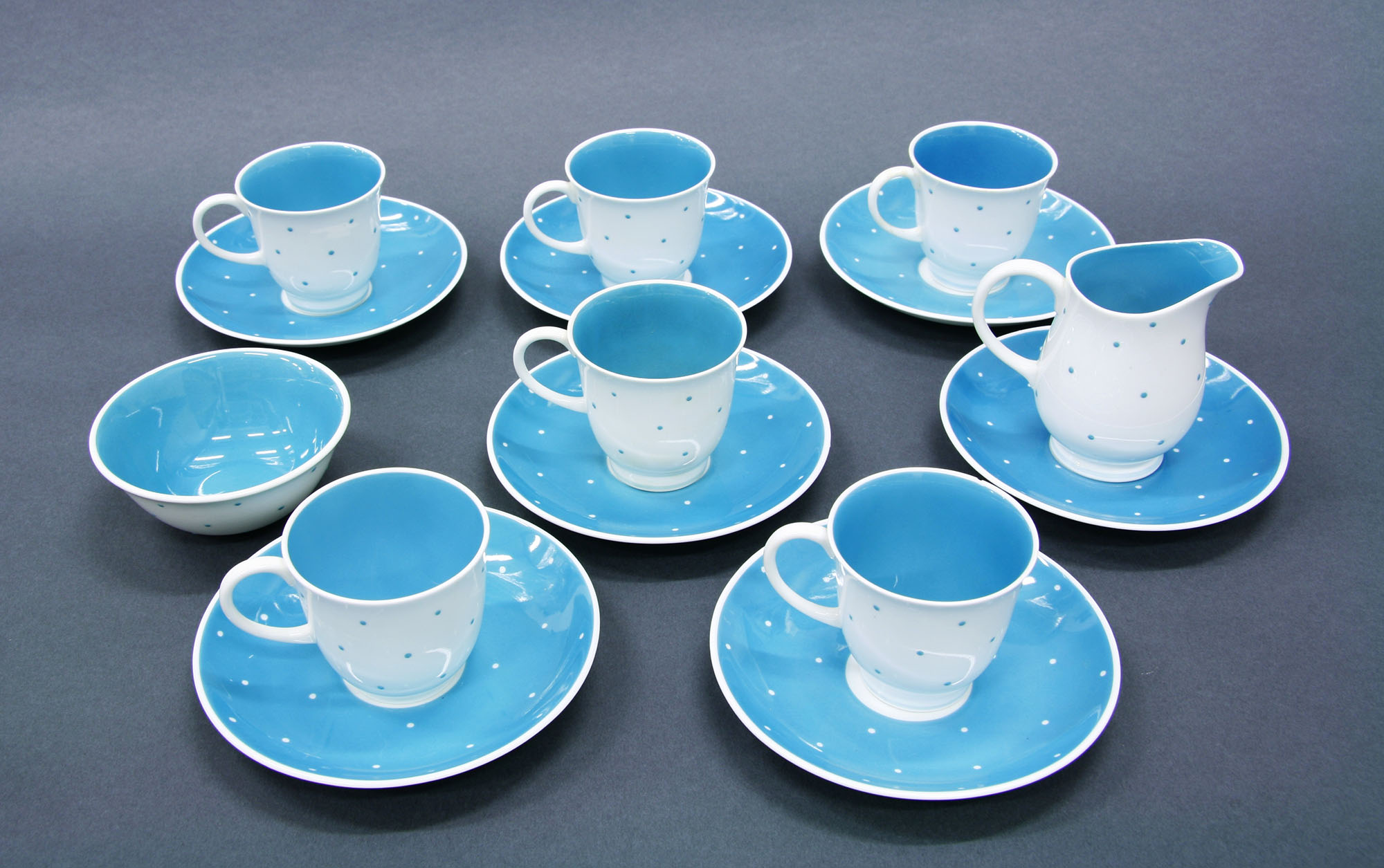 A set of blue and white cups and saucers