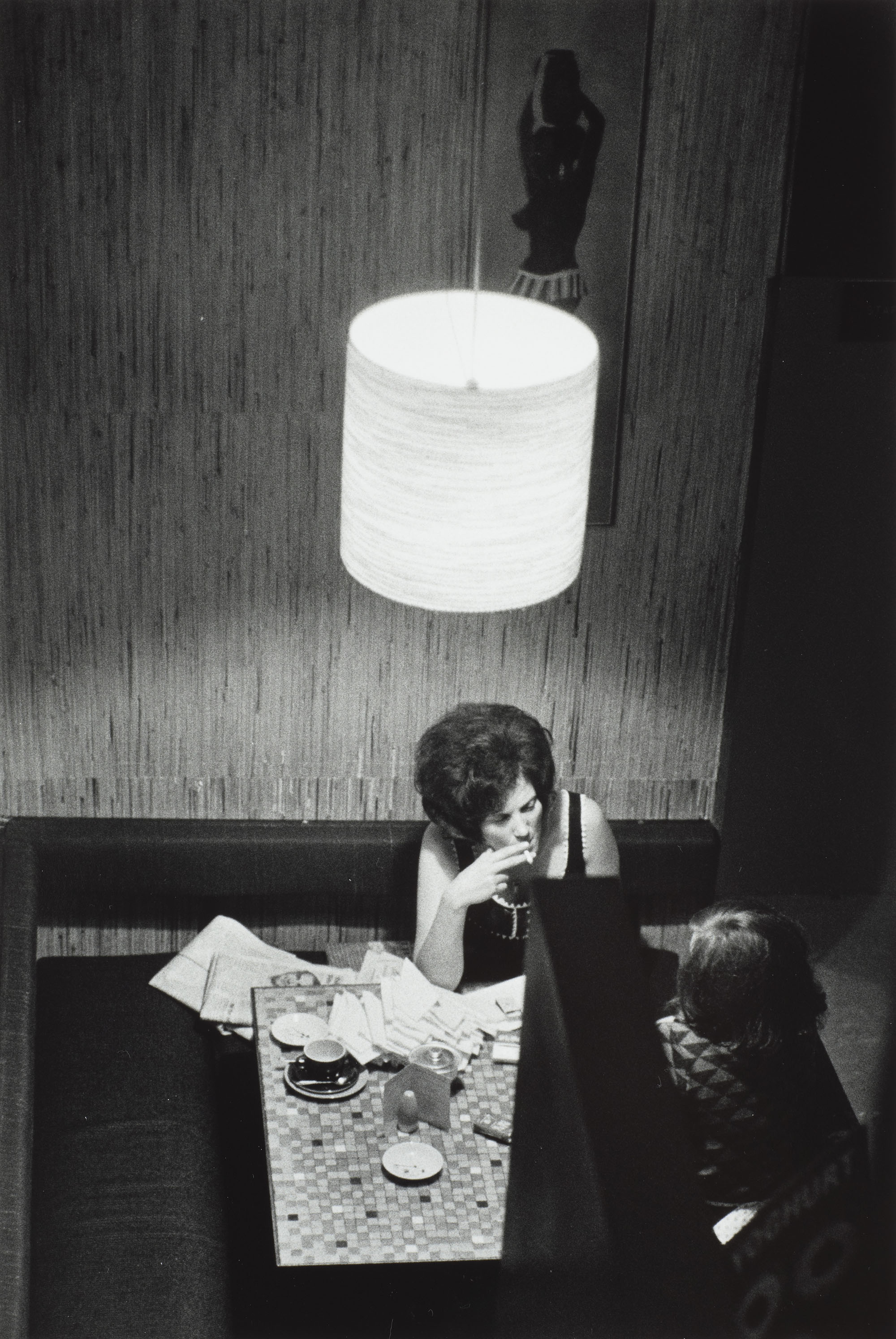 An overheard photo of two women sitting at a table with a pile of letters