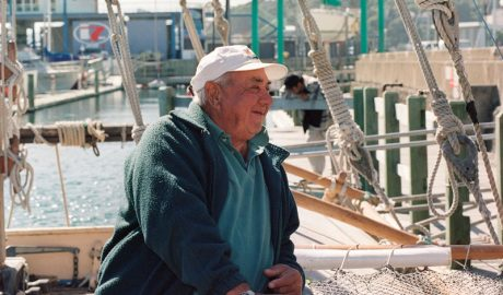Sir Hekenukumai Busby on a boat