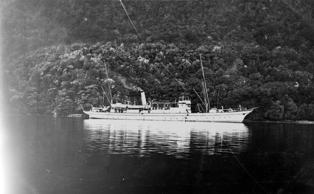 A black and white photograph of a ship