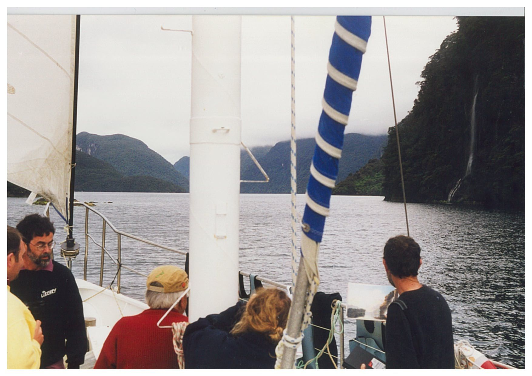 People on a boat in Tamatea, Dusky Sound, looking at the site of Hodges' painting