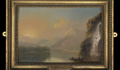 Illustrates Te Papa's recent acquisition - a painting by William Hodges showing a Māori man and women in a double-hulled waka. They are in a stunning fiord location with mountains rising into the distance and a waterfall cascading down the hill on the right hand side.