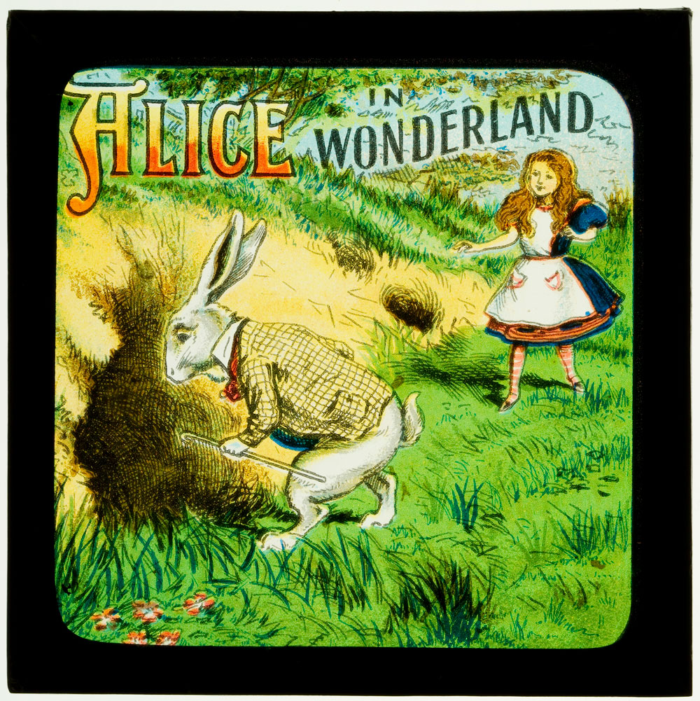 Illustration of Alice chasing the white rabbit down a hole