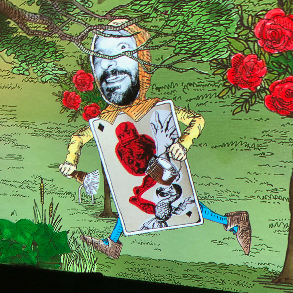 Photo of man's face is inserted onto the animated face of a card soldier from Alice in Wonderland