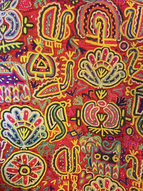Sample of brightly coloured fabric featuring an array of designs