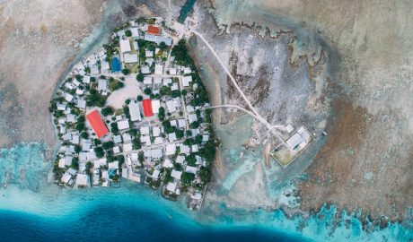 Arial view of a coastline with a small settlement