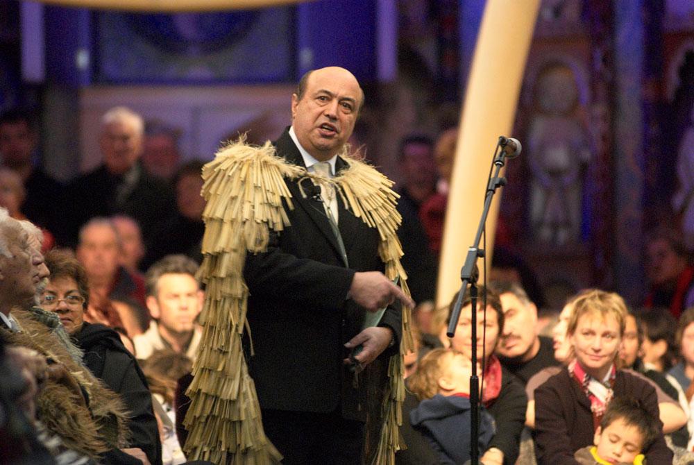 Piri addresses an audience, he wears a cloak
