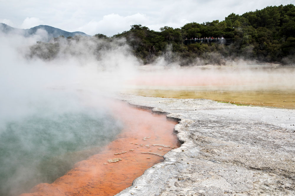 Steaming hot pool, it's a dark turquoise in the middle and bright orange around the outside