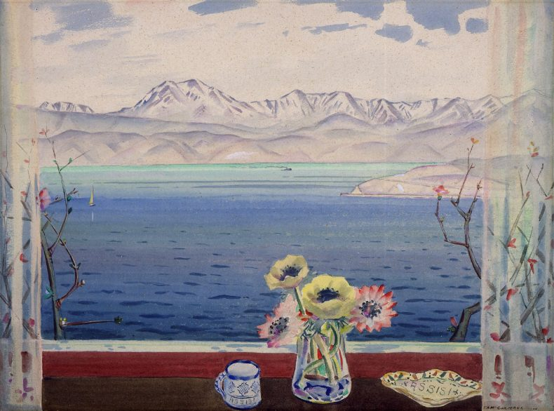 View through a window across the sea to a range of mountains. A vase of flowers and pottery sits on the windowsill.