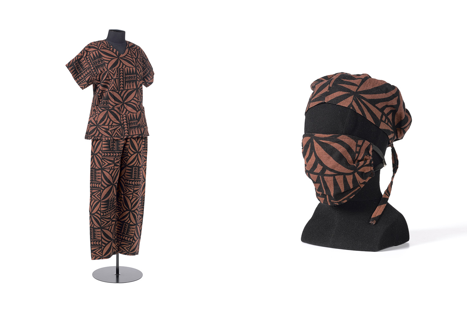 Doctors scrubs made of material featuring highly decorative Polynesian motifs in brown and black