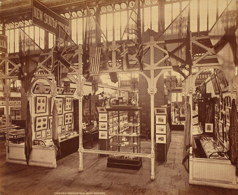 A sepia photo of a trade stand with shelves of wares on display